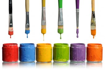 Image of paint Brushes dipping into paint containers