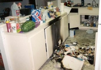 aftermath of a drug lab explosion, kitchen burned and covered with debris